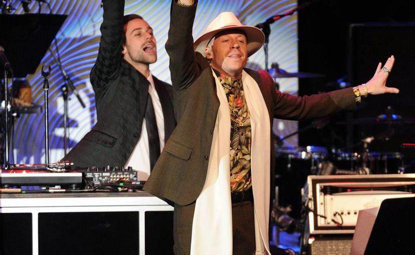 Macklemore durante su actuación en la 56 entrega anual del Grammy. (Agencias)