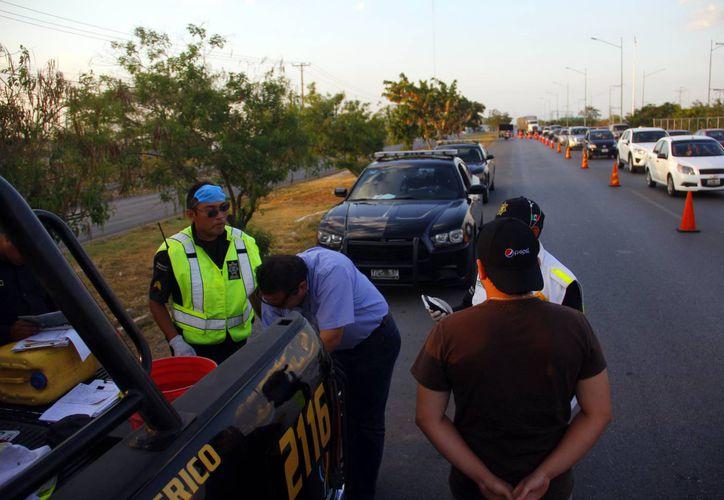 El operativo de seguridad se intensificará hoy y mañana en Mérida con la instalación de retenes. (Milenio Novedades)