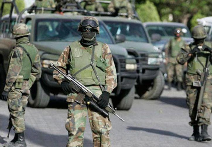 Tamaulipas ocupó el primer lugar en secuestros en el país. Hubo 62 víctimas de las 330 reportadas en México. En la imagen, Ejército patrulla las calles. (Archivo/diariocambio.com.mx)