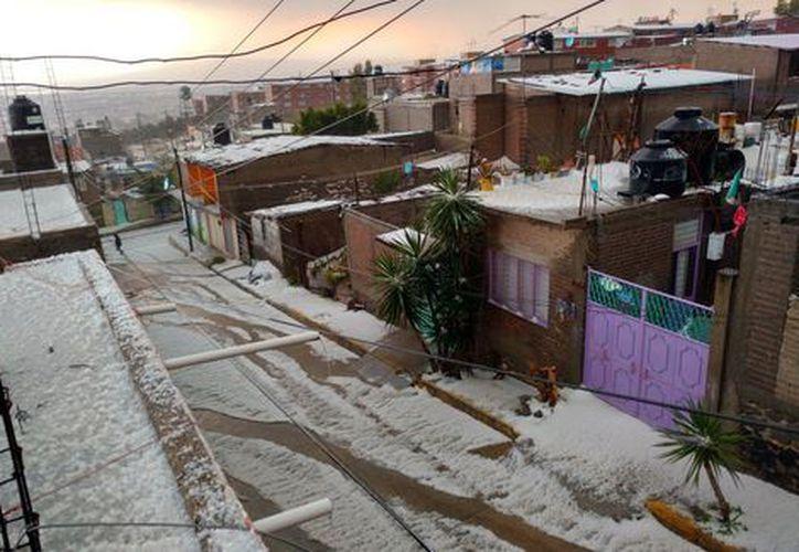 Gran parte de la Ciudad de México y Estado de México fue cubierta por una capa de granizo. (Foto: Milenio)