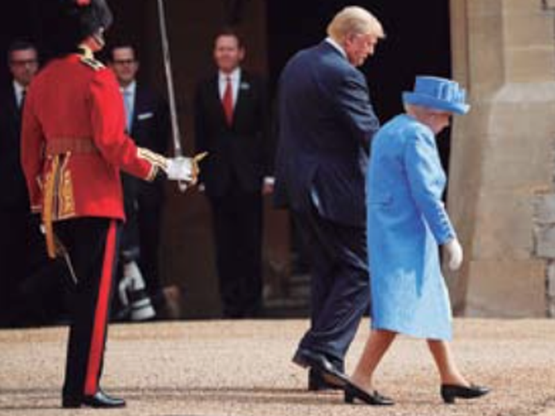 President Donald Trump with Queen Elizabeth II, as they walk out to begin to inspect the Guard of Honour at Windsor Castle in Windsor, England. (AP)
