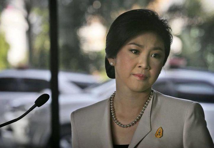 Imagen de Yingluck Shinawatra en el 2013 antes de ser acusada de negligencia en la gestión de un programa de subsidios del arroz. (Archivo/AP)