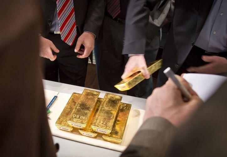 Como mínimo deberán perder dos kilos para obtener oro a cambio en este concurso. (EFE/Archivo)