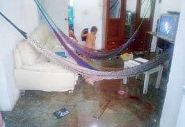 Los infantes rescatados, permanecían encerrados en su casa, mientras su padre trabajaba. (Redacción/SIPSE)