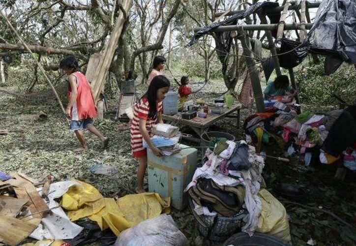 Cerca de 80 personas resultaron heridas pero lograron sobrevivir al diluvio en la ciudad de Nueva Batán. (Agencias)