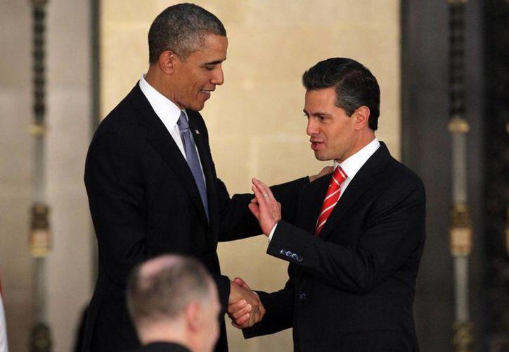 Peña Nieto y el presidente Obama sostuvieron un diálogo telefónico el miércoles, en el cual abordaron temas relativos a la economía de ambos países. (Archivo/Notimex)