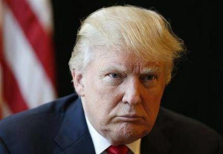 Ocho de cada diez hispanos que viven en E.U. considera como extremista a Donald Trump, quien buscará la presidencia de ese país, en noviembre. (AP)