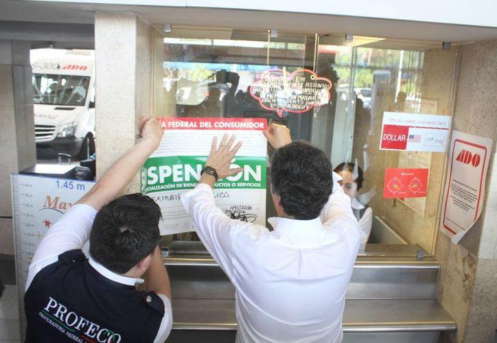 La Profeco colocó sellos de suspensión en algunos servicios que se ofrecen en Cancún. (Sergio Orozco/SIPSE)