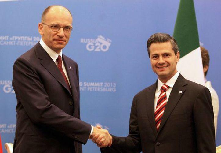 Enrico Letta participará en diversas actividades culturales y académicas. En la imagen, con el presidente Peña Nieto durante la cumbre del G20 en San Petersburgo, Rusia. (Archivo/Notimex)