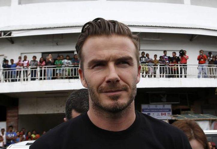 Beckham llega de sorpresa a Argentina para filmar un documental entre pobres. El rodaje también se realizará en otros seis países. (EFE)