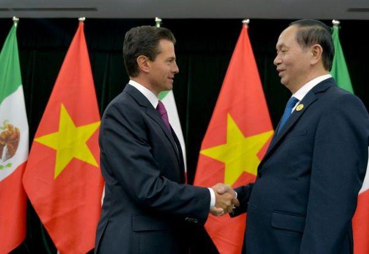 Peña Nieto se encuentra de visita en el país asiático. (Notimex)