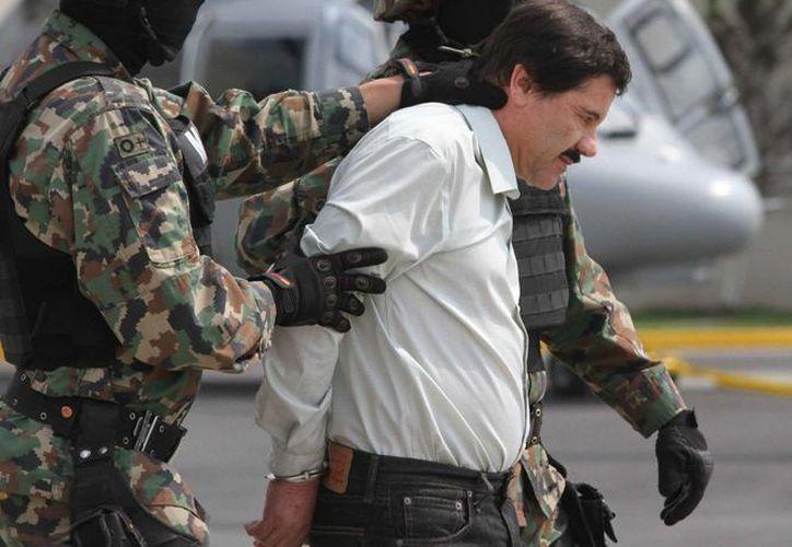 El mensaje del Presidente es en relación a la recaptura de 'El Chapo' Guzmán en los Mochis, Sinaloa. Imagen de archivo cuando el capo mexicano fue arrestado en febrero de 2014.(Archivo/Notimex)