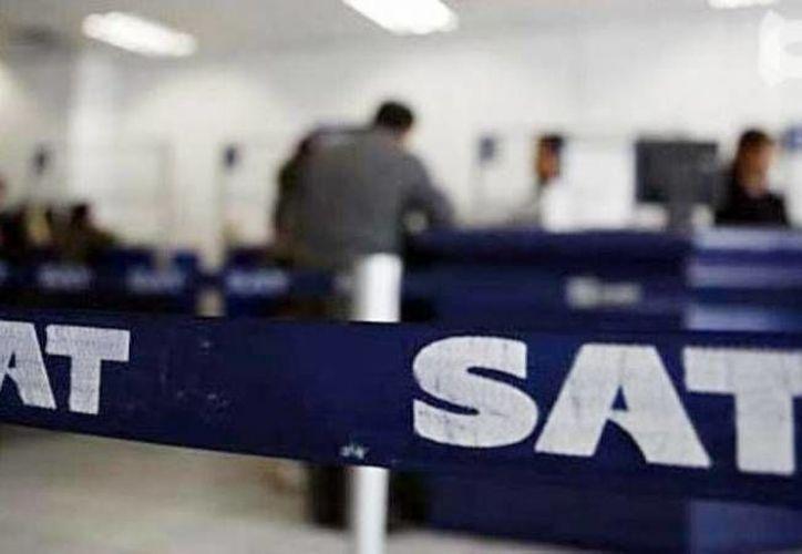 Los notificadores de impuestos están en riesgo en varias partes del país, admitió el titular del SAT, Aristóteles Núñez. La imagen es únicamente ilustrativa. (Archivo/SIPSE)