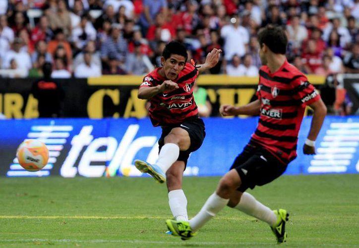 Cuando Atlas ya cantaba victoria, Puebla logra el empate. (Archivo Notimex)