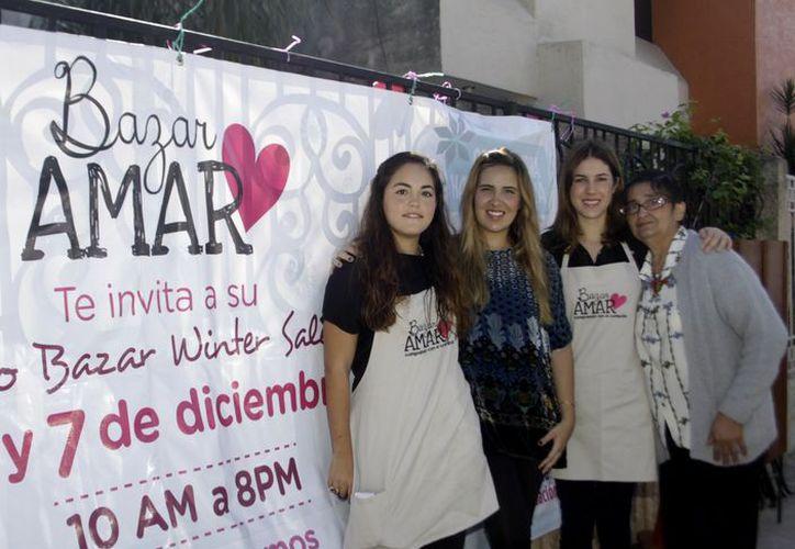 Coordinadoras del Bazar Amar con fines altruistas. (SIPSE)