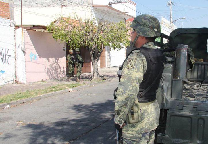 Los operativos en Michoacán contra templarios se sumarán a la intervención de minas con el fin de copar sus negocios millonarios y debilitarlos en su capacidad financiera. (Notimex/Contexto)