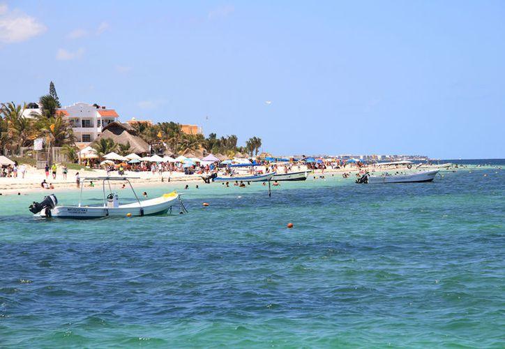 La temporada vacacional de Puerto Morelos en verano alcanzó 54 mil visitantes. (Luis/SIPSE).