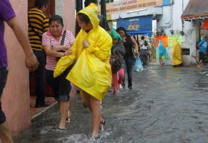 Una vaguada sobre la Península de Yucatán y el aporte de humedad de una nueva onda tropical sobre Honduras, generarán probabilidad de lluvia. (Milenio Novedades)