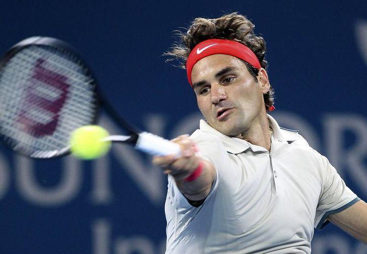 Roger Federer venció 6-4, 6-2 al finlandés Jarkko Nieminen y accedió a cuartos de final del torneo de Brisbane. (Agencias)