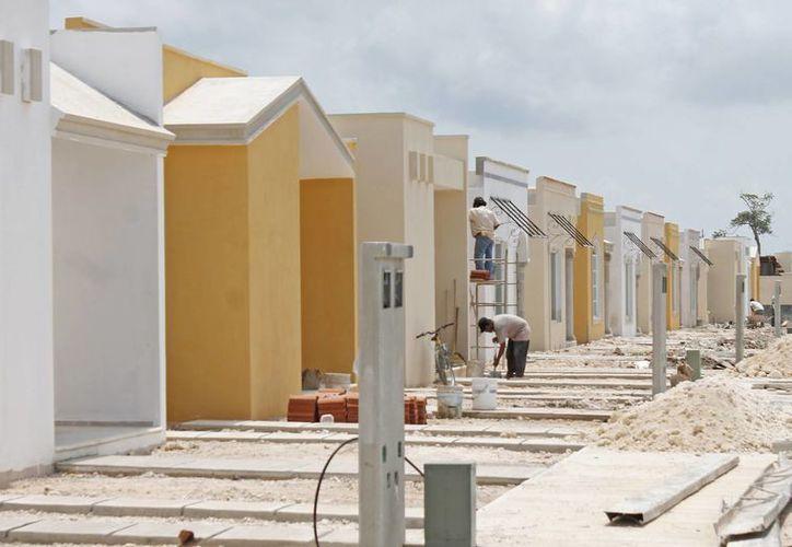 La mayoría de las personas compra viviendas que van por debajo de 590 mil pesos. (Jesús Tijerina/SIPSE)