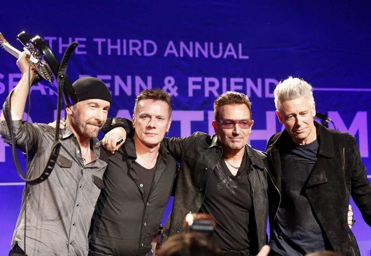 El libro titulado 'Tesoros de U2' pondrá al descubierto historias de esta banda irlandesa que el próximo año cumplirá tres décadas de trayectoria. (Archivo AP)