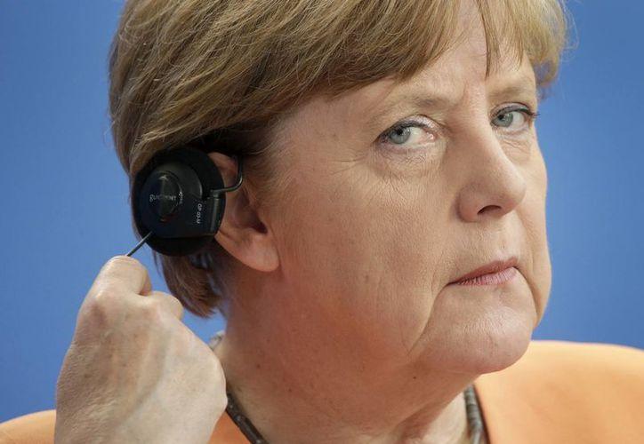 Las comunicaciones de Angela Merkel fueron blanco del espionaje de Estados Unidos. La razón: la negociación sobre la crisis griega. (AP)