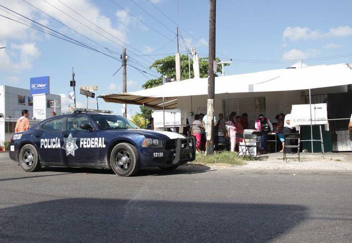 La jornada electoral fue vigilada por diferentes grupos de seguridad. (Consuelo Javier/SIPSE)