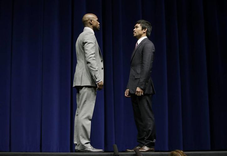 Las 'chispas' que se espera salgan durante el combate entre Floyd Mayweather Jr y Manny Pacquiao no hicieron su aparición durante la conferencia de prensa conjunta ofrecida por los púgiles. (Fotos: AP)