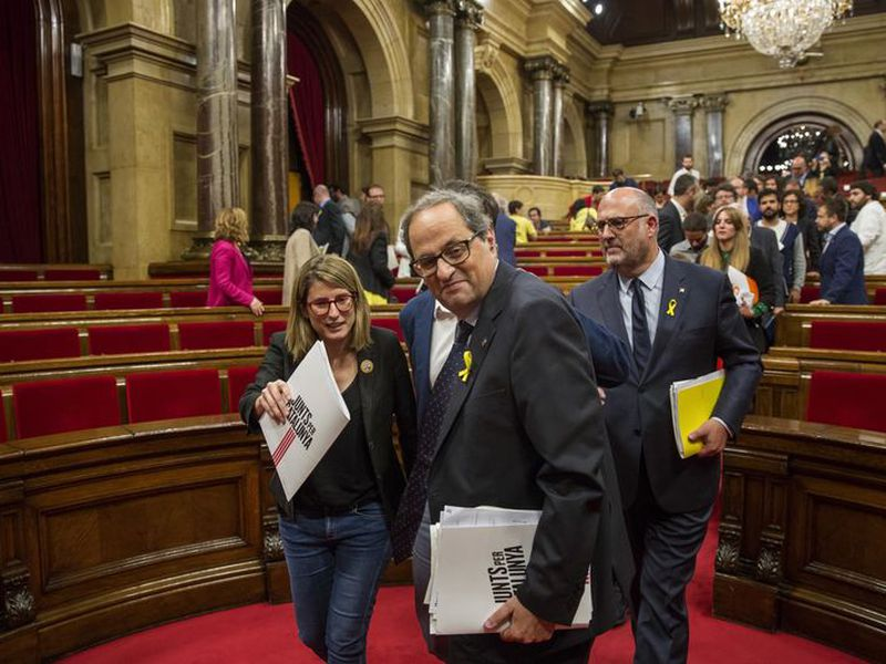 Separatist lawmaker Quim Torra, candidate for regional president, leaves the chamber at the end of the parliamentary session in Barcelona, Spain.