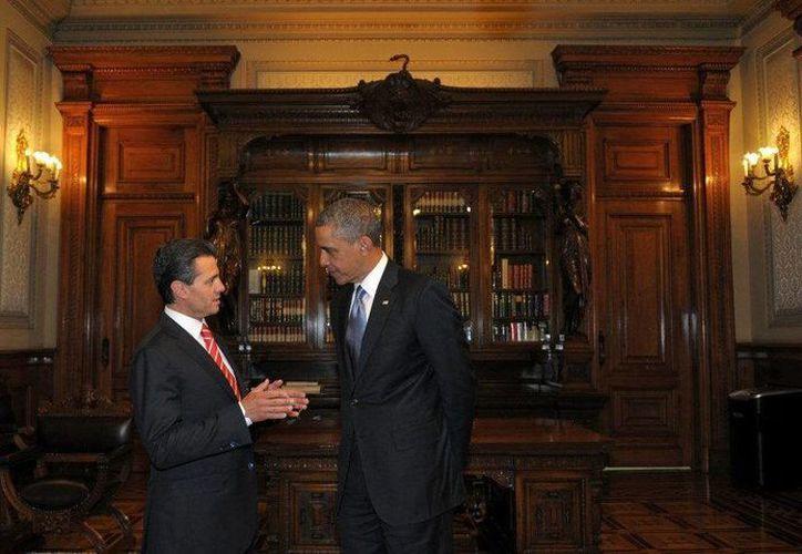 Los presidentes de México, Enrique Peña Nieto (izquierda); de Estados Unidos, Barack Obama (derecha), y el primer ministro de Canadá, Stephen Harper, celebrarán el 19 de febrero la VII Cumbre del TLCAN en la localidad mexicana de Toluca. (EFE/Archivo)