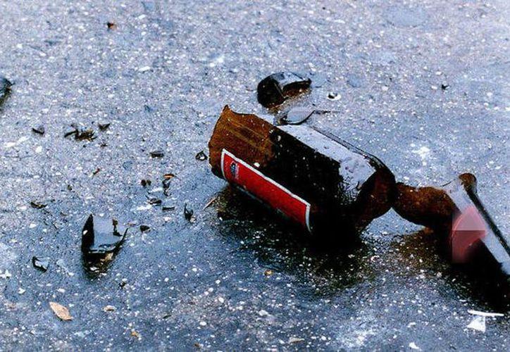 Niño muere al caer sobre los cristales rotos de una cerveza. Por cada envase le pagaban 1.50 pesos. (Archivo/Agencias)
