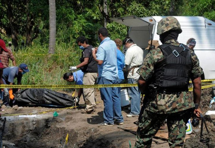 Las fosas clandestinas fueron localizadas en el municipio de Zitlala. (twitter.com/SergioyLupita)