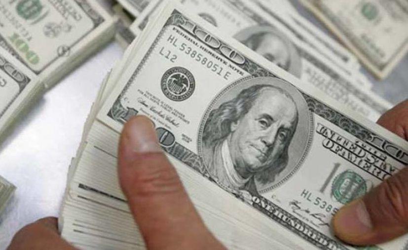 En centros cambiarios, la divisa estadounidense alcanzó una cotización a la venta de 13.19 pesos. (Archivo/Reuters)
