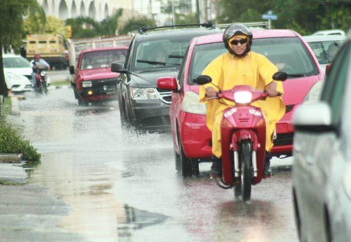 La Conagua pronostica un fin de semana caluroso, pero también lluvioso en Yucatán. (Jorge Acosta/Milenio Novedades)