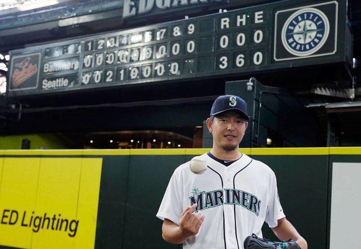 Iwakuma se convirtió en el segundo pitcher nacido en Japón que lanza un juego sin hit en las Grandes Ligas del Beisbol. (AP)