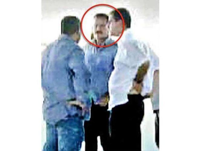 'El Abuelo' (círculo rojo) fue señalado en 2006 por varios asesinatos en Michoacán. (laopcion.com.mx)