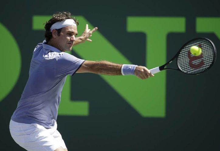 Roger Federer ha ganado 11 de los 12 partidos que ha jugado con el croata Ivo Karlovic. (Agencias)