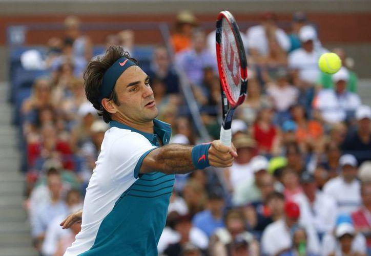 Roger Federer sólo necesitó una hora y 33 minutos para imponerse por 6-3, 6-4 y 6-4 al alemán Philipp Kohlschreiber en el Abierto de Estados Unidos. (EFE)