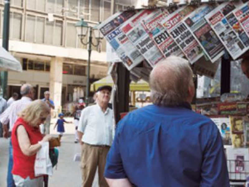 People read newspaper front pages a day after a Greek- Macedonian agreement, at a kiosk in Athens. (Ap)