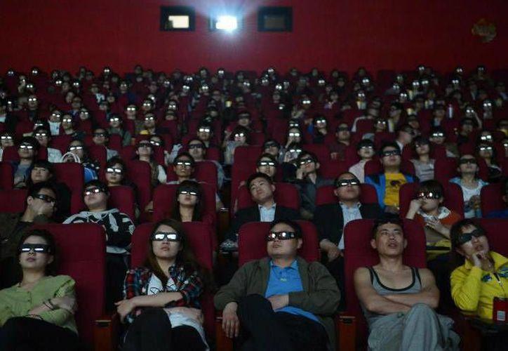 De acuerdo a las estadísticas, China supera por 10 mil salas de cine a los Estados Unidos, quienes son considerados una potencia en ese ámbito.(Archivo/AP)
