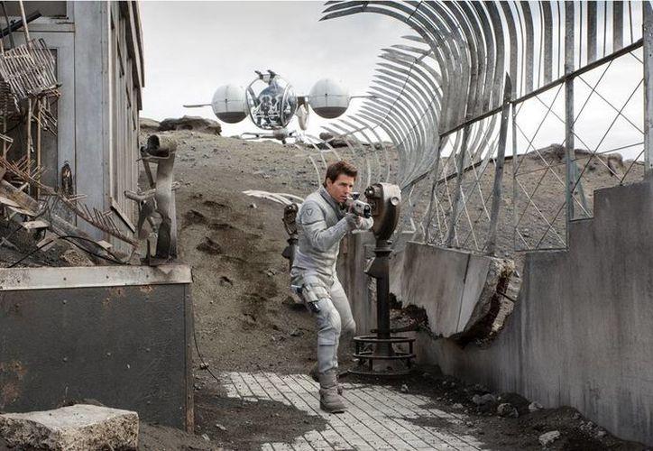 La cinta estelarizada por Tom Cruise recaudó en su estreno 38.2 mdd en taquillas de EU y Canadá. (Agencias)