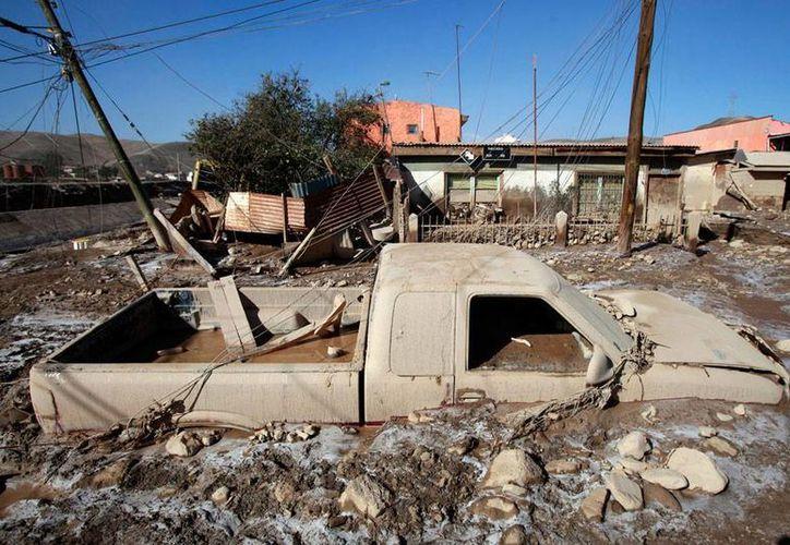 Al menos 101 personas están reportadas como desaparecidas en Chile, luego de las intensas lluvias que han dejado 25 muertos. (elhorizonte.com)
