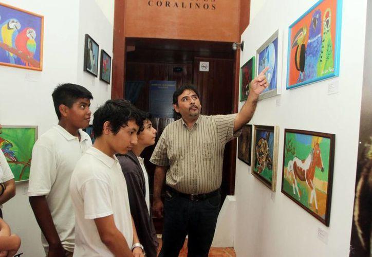 Alumnos del taller 'Greart Arte' presentan 56 cuadros con temas sobre flora, fauna y paisajes de la península de Yucatán. (Amílcar Rodríguez/Milenio Novedades)
