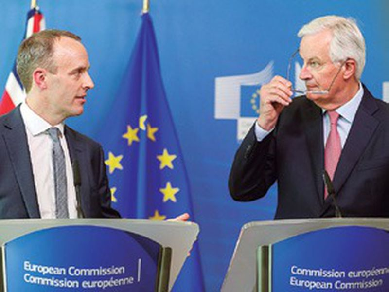 Britain's newly appointed chief Brexit negotiator Dominic Raab, left, and EU's chief Brexit negotiator Michel Barnier, in Brussels.