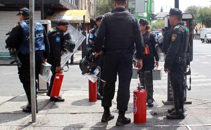 La policía capitalina girará órdenes de aprehensión contra los identificados. (Notimex)