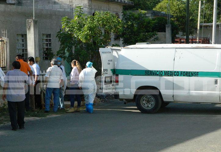 Una mujer fue asesinada en Tekax, presuntamente por su marido, un policía municipal. (Imágenes: SIPSE)