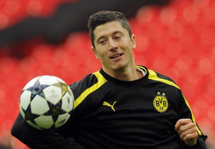 En la última campaña, Lewandowski anotó 10 goles en Champions League y 24 en la Bundesliga. (EFE)