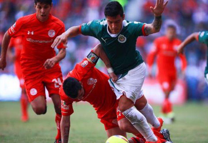 El jugador Alexis Vega adelantó al conjunto de casa al minuto 22; mientras que Javier Eduardo López logró el tanto de la paridad al minuto 52. (Contexto/Internet)