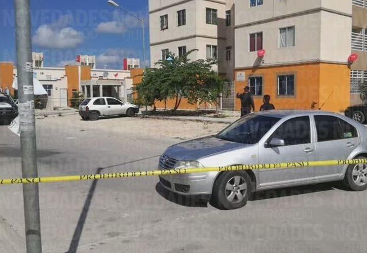 Los cadáveres están embolsados, en un departamento de la zona. (Orville Peralta)