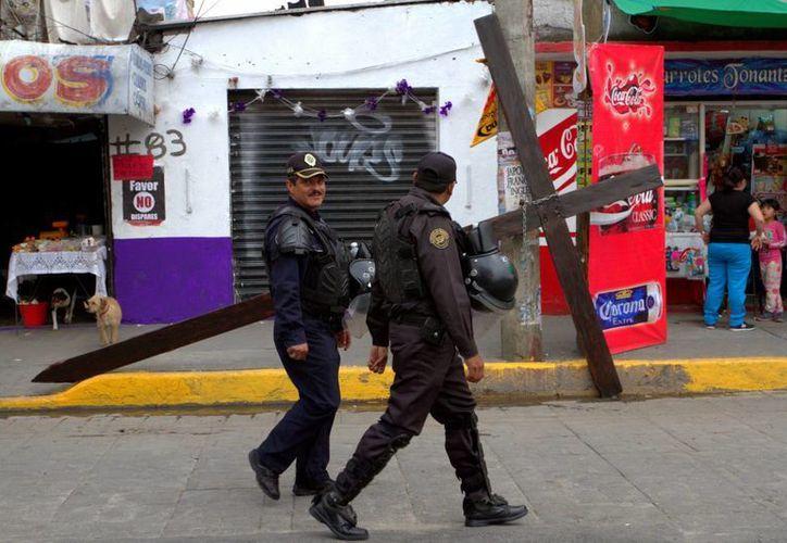 Se ordenó el despliegue de más de 10 mil policías en la zona donde se representará el Viacrucis en Iztapalapa. (Notimex)